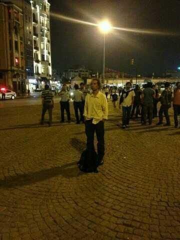 #duranadam after the violent attack on protestors on Sunday, Erdem Gunduz started a passive protest by standing in the middle of Taksim Square, staring at the Turkish flag and Ataturk's picture for 6 hours, until he was arrested. Other poeple joined his still protest and formed a human chain.