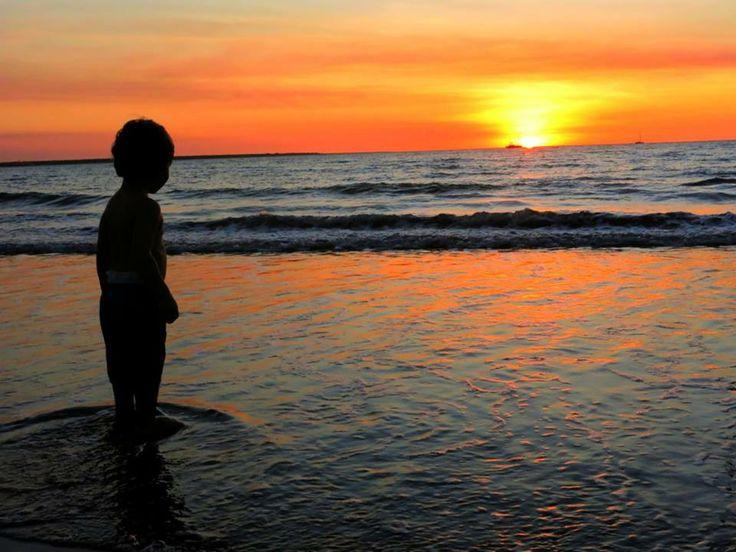 Little boy Luke loving the Mindil beach sunset, Darwin Australia