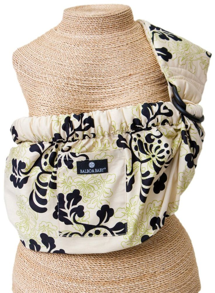 If I could go back and get a sling this would be the one.  Saw it at a baby shower.  So much easier than moby.  Looked more comfortable than ergo.  But I like carrying things messenger style.