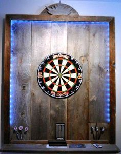 Pallet wood dartboard edging with LED lighting strips – ideal for a man's cave