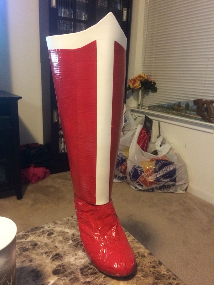 Wonder Woman boots - used craft sheet and red duct tape and the shoe part has an old sock covering it and then I duct taped the sock so I didn't ruin my shoe. Make sure to give room so you're able to take your foot out of the shoe and sock.