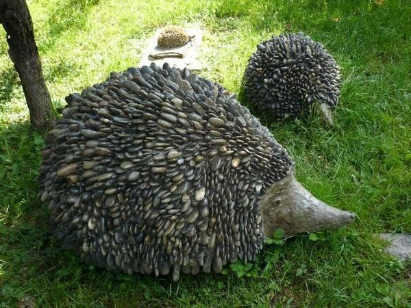 stone hedgehogs would be so fun tucked in a corner of my yard!