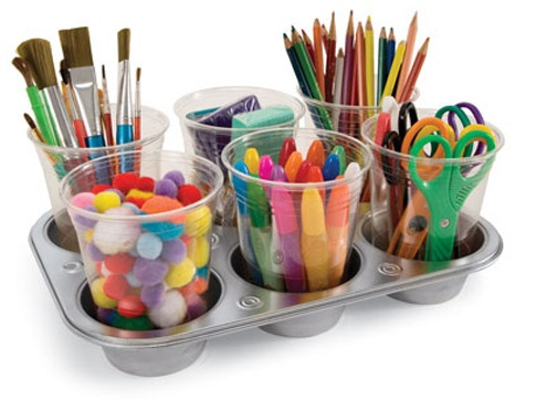 A muffin pan becomes a craft caddy. Magnets hold the plastic cups down to make them tip-resistant... via familyfun.go.com