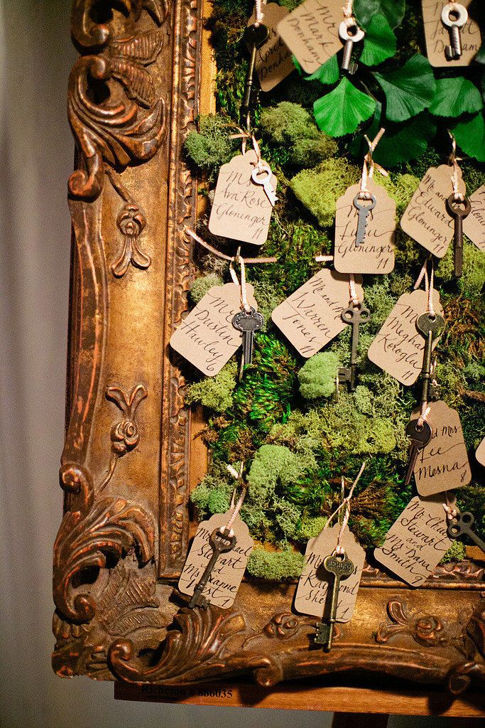 Moss filled frame with wedding name tags & antique keys ~