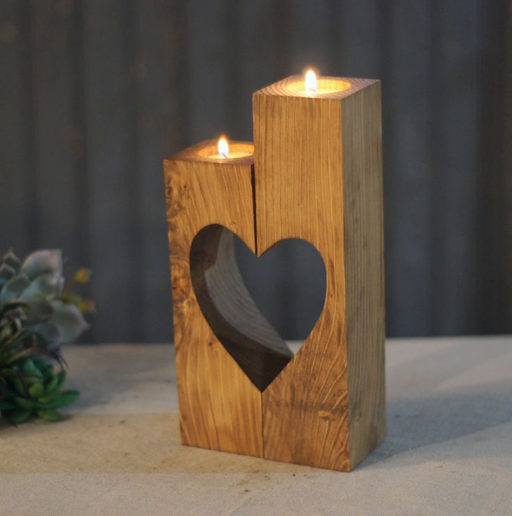 "Reclaimed Wooden Cube Candle Holder Set of 2 Tealight Holders with heart cut-out. Stained a warm chestnut. Approx Measurements: 4-6"" in Height May have knots, cracks or imperfections. Looking to add s"