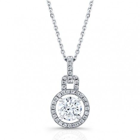 This gorgeous pendant displays a modern element to the classic elegance of a diamond solitaire necklace. The setting showcases excellent craftsmanship and design. Beautiful round brilliant cut diamonds encircle the center stone without touching it creating the look of a floating center diamond. Additional diamonds adorn the top of the pendant and add elegance and sparkle. SKU # 3750232