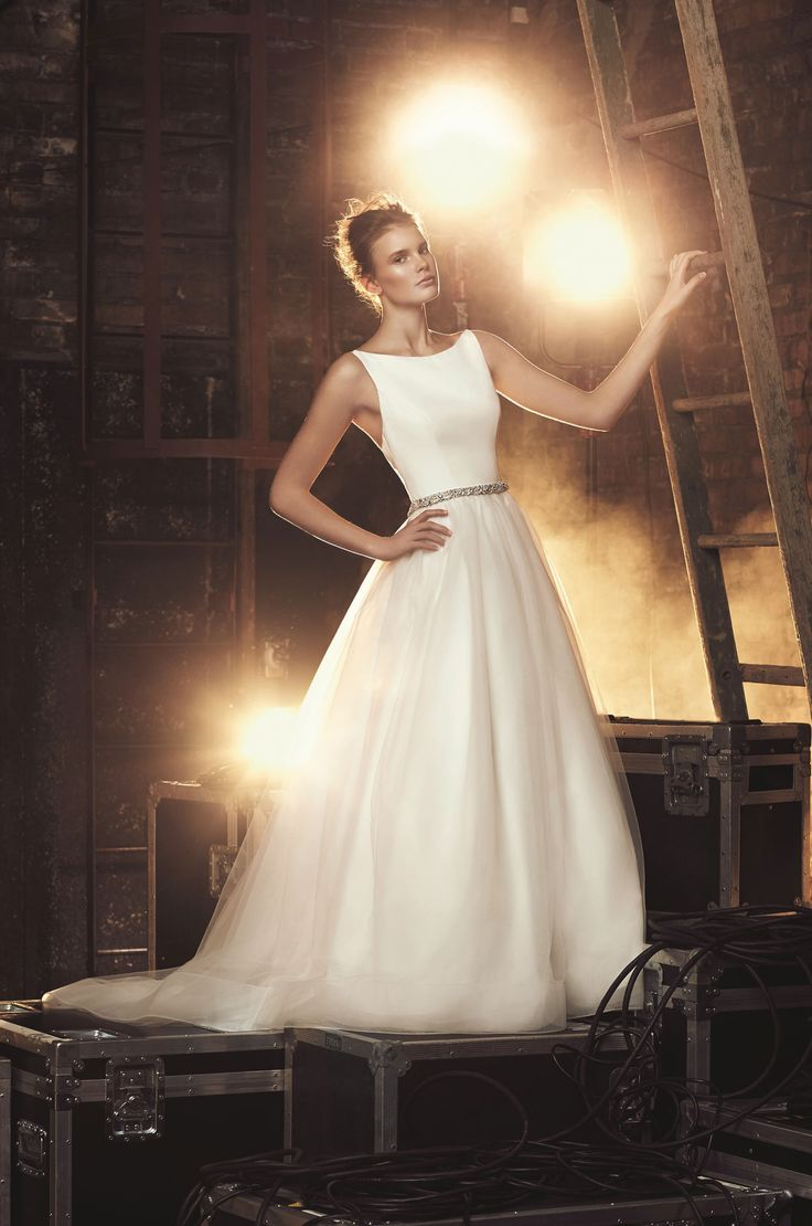 View our Tulle Skirt Wedding Dress - Style #2079 from Mikaella Bridal. Sleeveless crêpe bodice with bateau neckline and crêpe straps. Gathered tulle skirt.