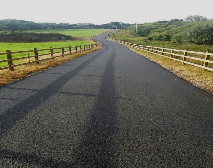 A long driveway to a farm yard all ground work and drainage was done by kerry tarmacadam