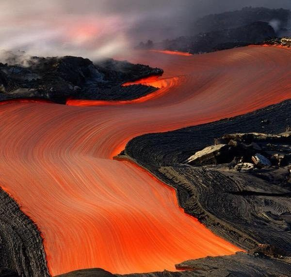 This stream of lava is so beautiful that you almost want to reach out and touch it. | 23 Pictures So Perfect You'll Almost Hate Them