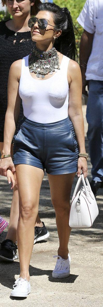 Who made  Kourtney Kardashian's white sneakers, silver jewelry, aviator sunglasses, tank top, and handbag?