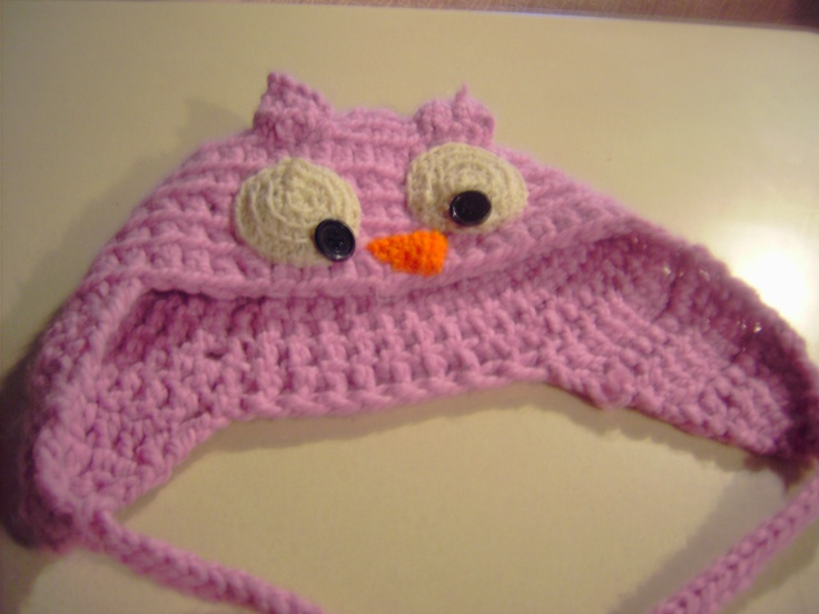 Owl hat of my own design. I used a basic earflap hat pattern and created a face.