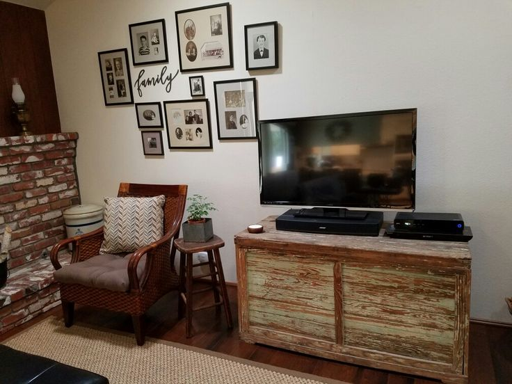 Because I hate the look of wires from my TV, etc. I searched for a unique TV stand and found this old bin with chippy paint.   I really love it!
