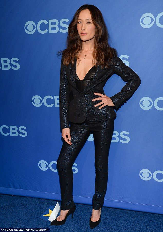 She's still a badass! Former Nikita star Maggie Q will be back kicking butt in Stalker, which CBS programming chief Nina Tassler has called 'easily the scariest show we've ever done', while she dazzled on the blue carpet in her sexy blue-black sequinned pantsuit and plunging black leather top