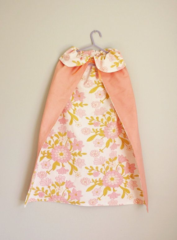 The perfect dress up cape for your little princess, pink fabric on the outside and fully lined with a floral cotton and tying with a
