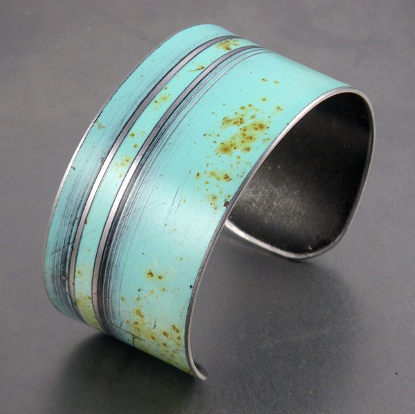 "Cuff Bracelet Made using vintage automotive steel, this cuff was made from a 55 Ford Fairlane. The color is the original Blue car paint left intact while the design was hand etched into the metal. The cuff measures 1 1/4"" wide. The steel can be easily adjusted to fit most wrist sizes."