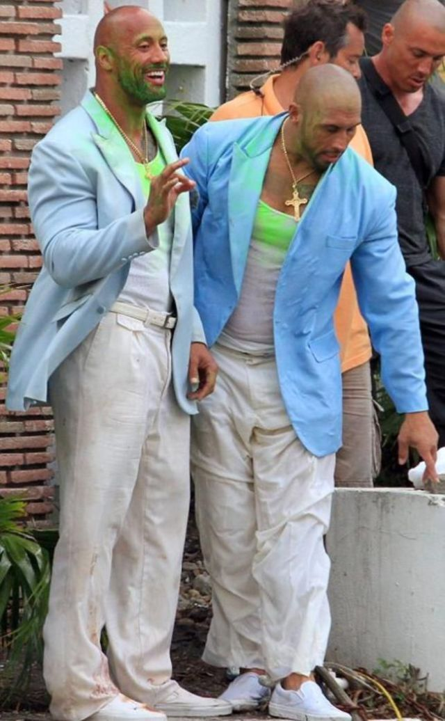 Famous Faces and Their Less Famous Stunt Doubles .. Dwayne Johnson (The Rock) on the set of his upcoming movie Pain and Gain (2013).