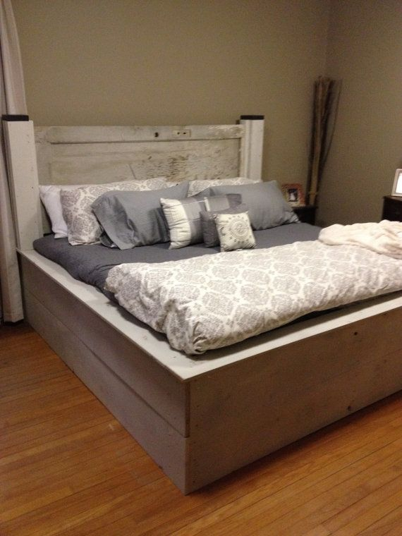 king platform bed with old door as headboard