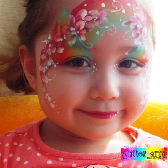 Rainbow and Flowers Face Painting on a little girl by Glitter-Arty Face painting, Bedford, Bedfordshire