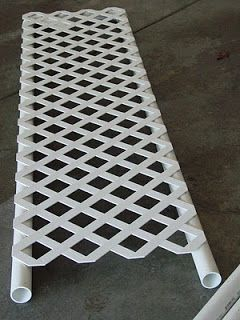 "Trellis made of PVC and  fence piece. This could be used as a component of your raised garden. I wonder if I could use it as a temporary ""fence"" visual border by pounding rebar into the ground and placing the vertical PVC poles over it."