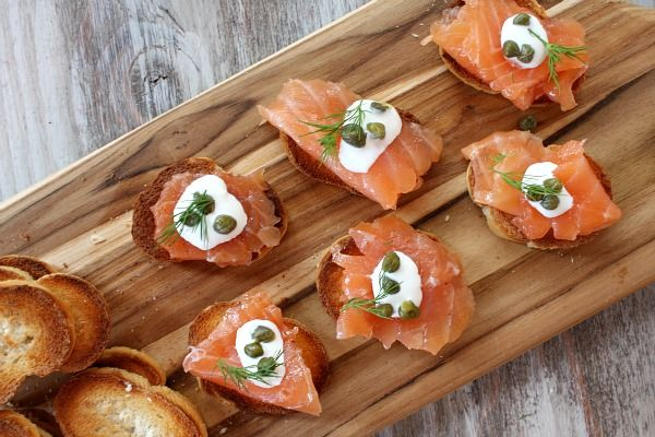 Norwegians traditionally eat Gravlax on open-faced sandwiches or with stewed potatoes and gravy (which I included a recipe for below).  I chose to serve it up appetizer-style instead… on toasted baguette slices with a small dollop of creme fraiche, a sprinkle of capers and a garnish of dill.