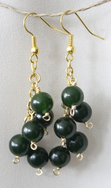 Golden earrings with green beads