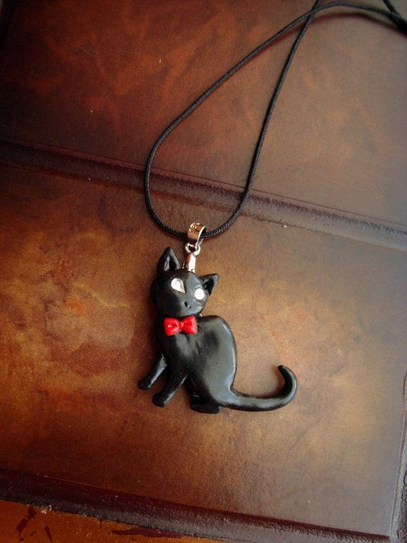Check out this item in my Etsy shop https://www.etsy.com/listing/222710123/black-cat-with-red-bow-tie-necklace