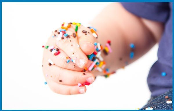Dip hand in water and then in sprinkles - photograph the baby trying to eat the sprinkles off! Doing this for Liam's cake smash!
