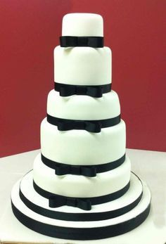 5 tier hexagon wedding cake with fresh roses and red ribbon ...