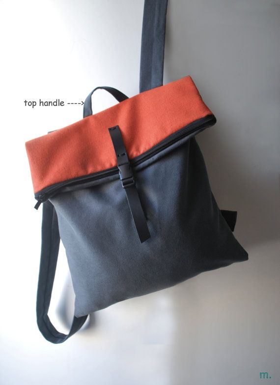 « THE POSTBAG waterproof dark gray - orange/red » is a lightweight backpack / messenger bag, geometrically cut, minimally designed. As a practical, every-day bag, it can be worn either on one shoulder by letting the one strap free or as a messenger bag. Suitable and safe for