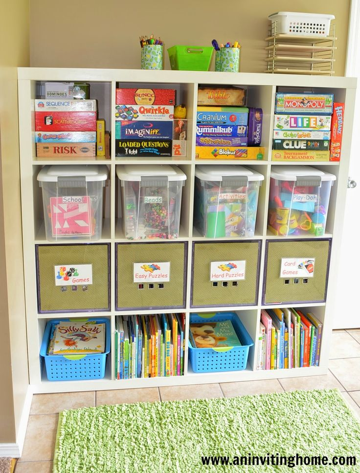 How to organize games and toys in your kids playroom. Great storage ideas!