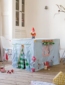 Super cute table playhouse.