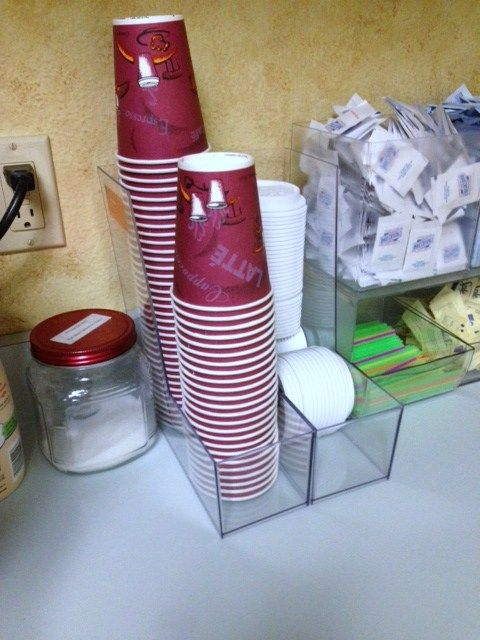 I used magazine holders from Target ($2.50 each) to organize the cups and lids in the office break room