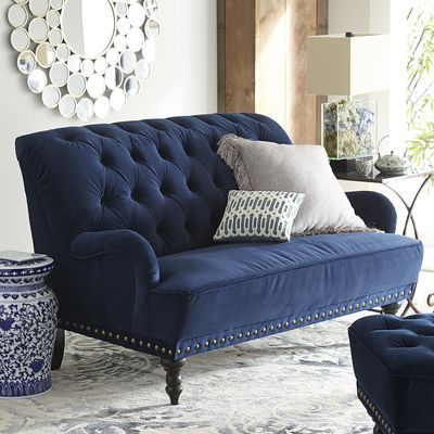 Now that's what we call estately. And you will, too, once you've seen what our handcrafted Chas Loveseat can do for your decor. Carved hardwood legs, button-tufted velvet upholstery and handsome, hand-finished nailhead trim make it an instant classic—all without squandering the estate.