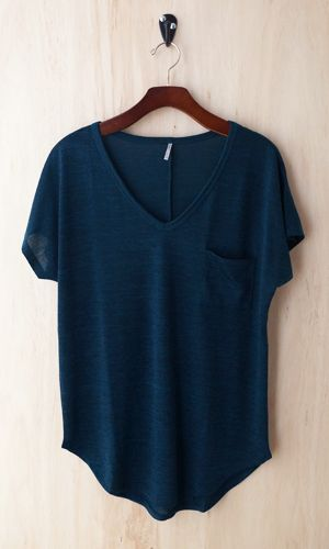 OH SO COZY TEE!  We are obsessed with this super soft, slinky, and cozy knit tee. With an elegant v-neck, and medium body fabric, this tee shirt drapes perfectly!