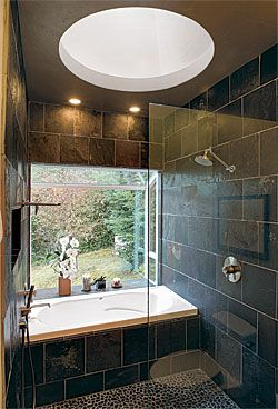 Open bath/shower, green space, natural lighting, overhead light, stone.
