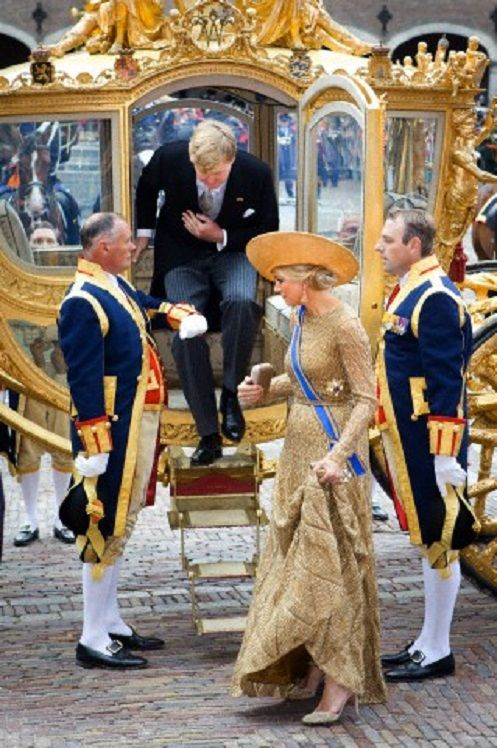 Dutch King Willem-Alexander and Queen Maxima arrive by the golden carriage at the Ridderzaal at Princes day parade the traditional opening of the parliamentary year in The Hague, The Netherlands, 17 Sep 2013.