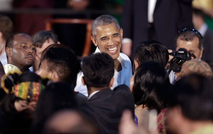 President Barack Obama greets people in the audience after…