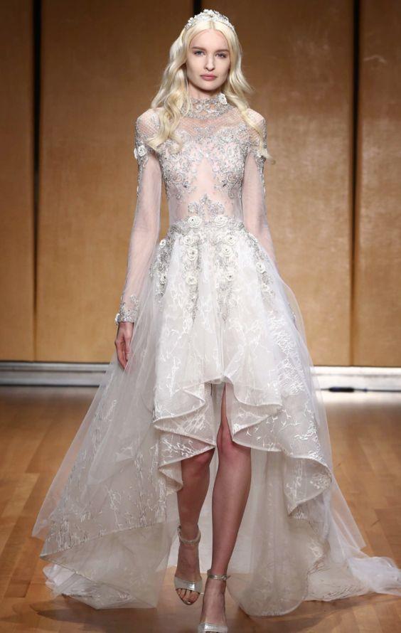 Glamorous long-sleeve embellished high neck wedding dress with beautiful high-low skirt; Featured Dress: Inbal Dror