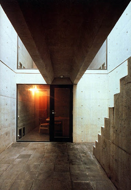 Row House (Azuma House) 住吉の長屋 Tadao Ando 安藤忠雄 | a small two-story, cast-in-place concrete house completed in 1976, is an early Ando work which began to show elements of his characteristic style. It consists of three equally sized rectangular volumes: two enclosed volumes of interior spaces separated by an open courtyard. By nature of the courtyard's position between the two interior volumes, it becomes an integral part of the house's circulation system.