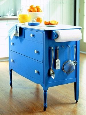 My next project: Space-Savvy Ways to Store Cooking Equipment. Dresser turned kitchen island