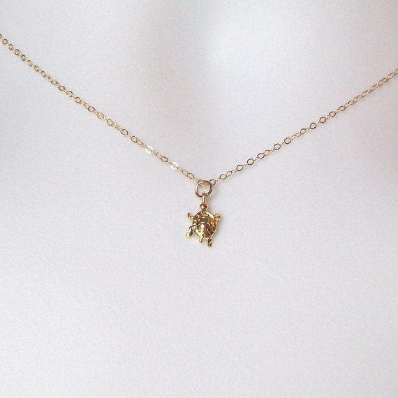 """Tiny Gold Turtle Necklace, Gold Filled Necklace    This Gold Tiny Turtle Necklace is a Gold Plated Turtle Charm hanging from Gold Filled Chain. The Findings and Spring Ring Clasp are also Gold Filled.    It's 15"""" long and can be adjusted to your preferred length up to 20 inches. Anything longer there will be an additional charge.     