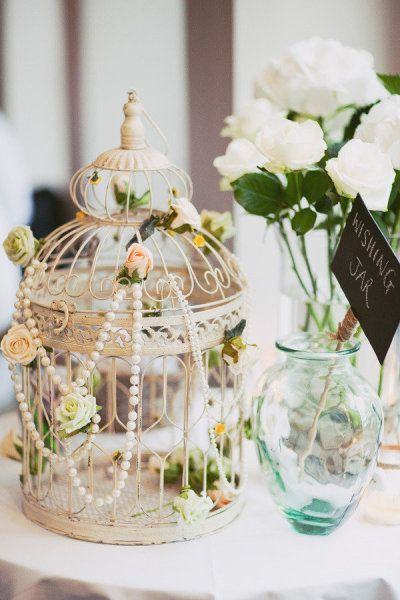 vintage birdcage with flowers and pearl wedding centerpieces / http://www.deerpearlflowers.com/vintage-pearl-wedding-ideas/2/