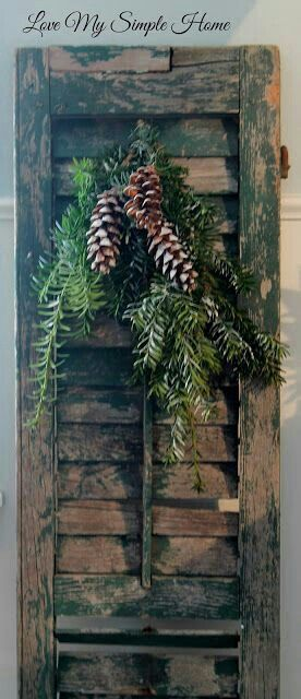 Shutter with pine cone decoration..rustic and pretty