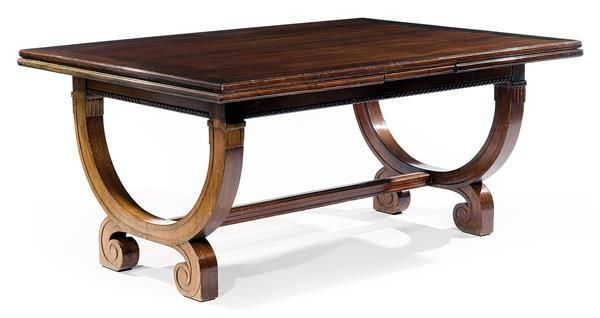 LOUIS SÜE & ANDRÉ MARE: A rectangular extending mahogany and mahogany veneer dining table