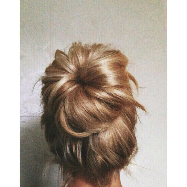 Messy high donut bun
