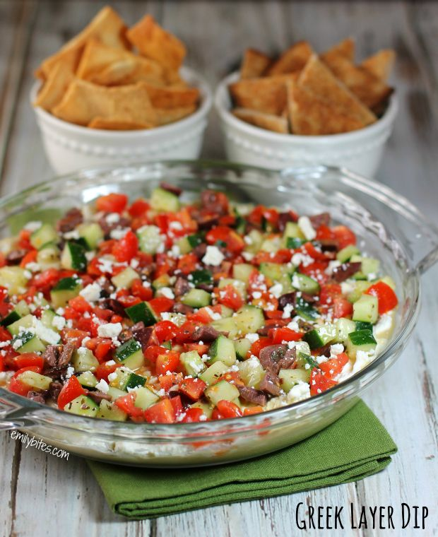 This Greek Layer Dip is your new potluck go-to! With tasty Sabra hummus, a thick and creamy Feta cheese layer, and Mediterranean vegetables tossed in a Greek vinaigrette, it's a flavor explosion you won't be able to get enough of . #dip #weightwatchers #sponsored