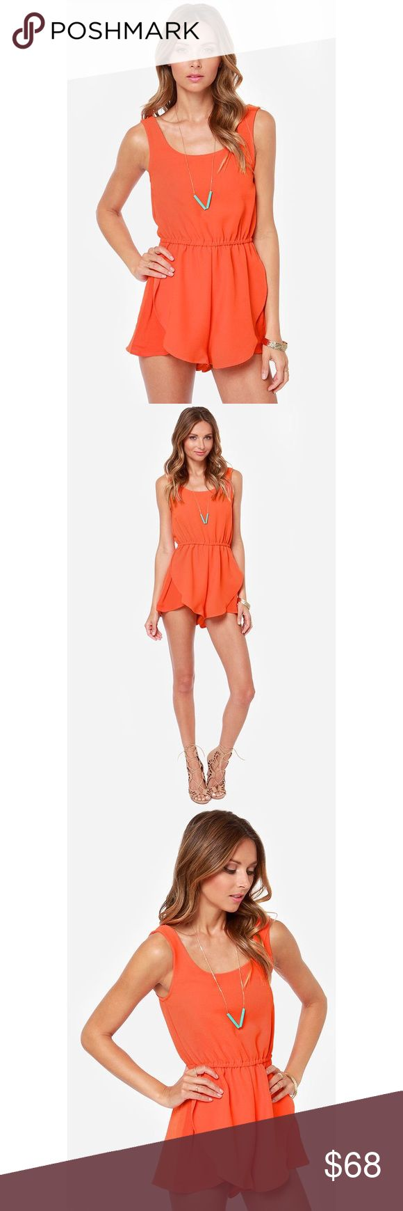 """MINKPINK Coral Tulip Romper - NEVER WORN Go after what you want you want most in the Mink Pink The Seeker Orange Romper! A medium weight woven material in bright orange forms a sleeveless bodice with a sweet scoop neck. An elasticized waist is met by attached shorts with flirty tulip style hems. Unlined. Model is 5'9"""" and is wearing a size X-small. 100% Viscose. Machine Wash Cold. Tag says large but can fit a medium  MINKPINK Pants Jumpsuits & Rompers"""