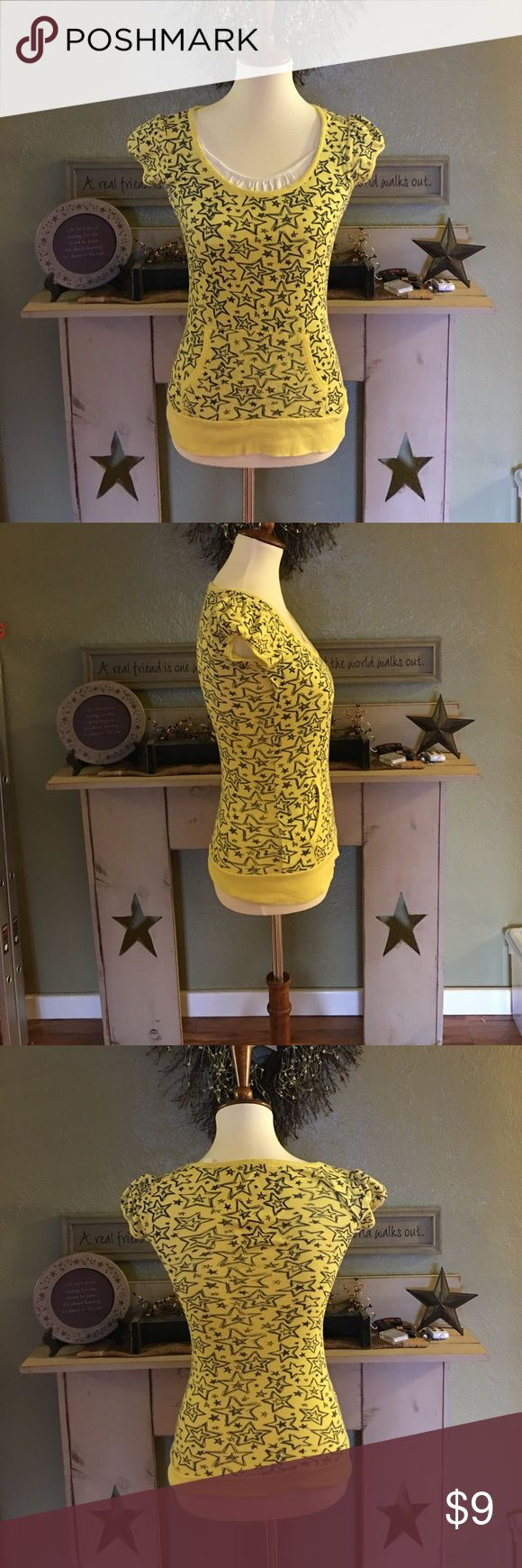 Yellow short sleeve shirt This is a yellow juniors medium shirt from Kohl's it's like new navy blue stars on it And a little pocket across the front. Excellent condition no rips or stains. Tops Blouses