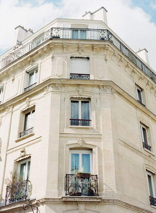 Parisian building in the spring. Photography by Heidi Lau.