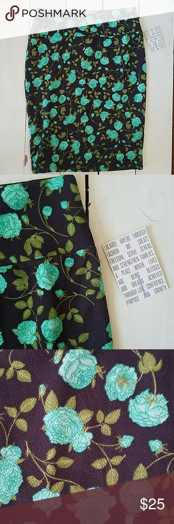Aqua green floral print LLR Cassie (pencil skirt) Fun flirty pencil skirt in size large by Lularoe. Black background with aqua green floral and green leaves. LuLaRoe Skirts Pencil
